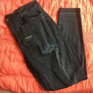 Plus sized Distressed charcoal jeans