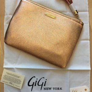 Rose gold Gigi leather clutch. Brand new!