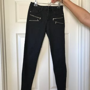 Faded black jeans with zipper details from Zara