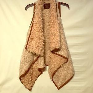 Fur vest with brown leather detail
