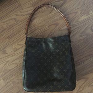 Louis Vuitton large looping bag.