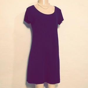 Sleek, Gorgeous, Black mini dress.