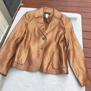 Ladies bronze color leather jacket.