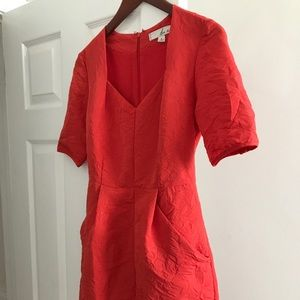 Tangerine colored mid thigh dress with POCKETS!