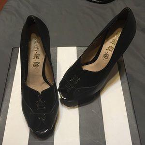Gently used lamb platform heels