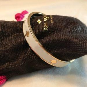 Kate Spade white and gold spade bangle bracelet