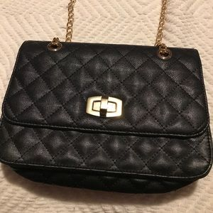 Express black patch and gold chain crossbody