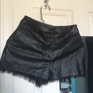 Black pleather shorts with lace trim