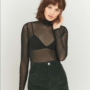 Minimalist light after dark turtleneck top