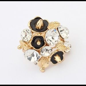 NWT Gold ring with black flowers, adjustable