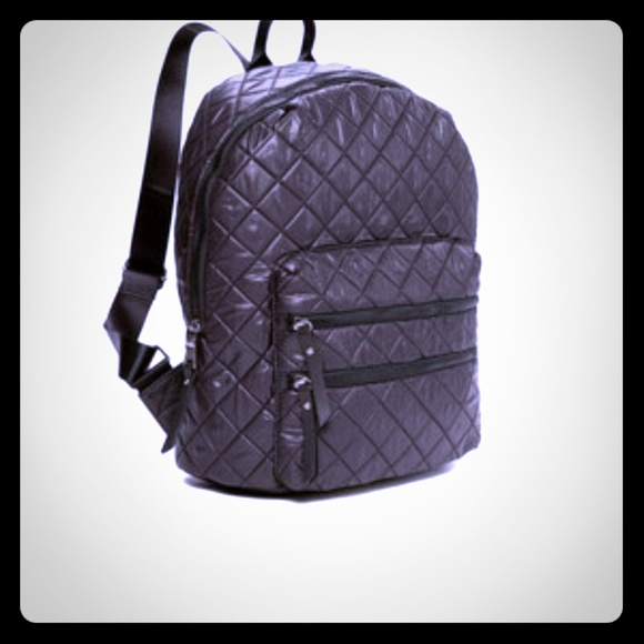 6f6458f443d Steve Madden Quilted Puffer Black Backpack. M 59c88ed8291a35f37d061358