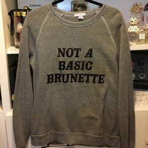 "Sweatshirt with ""Not a basic brunette"" on sweater"