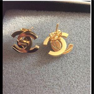 Gold turn lock earrings