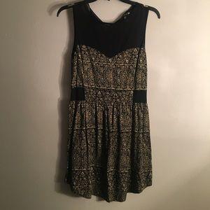 Black and gold tribal print dress