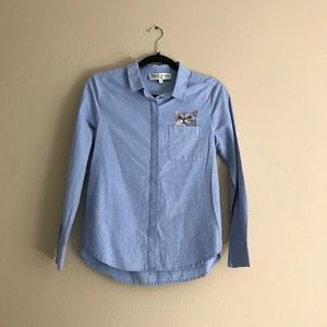 Cat embroidered blue shirt.