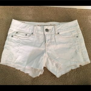 Destroyed white denim shorts