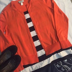Orange cardigan and navy and white striped tank