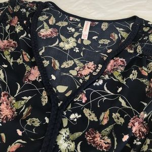 Floral peasant top with braided neckline