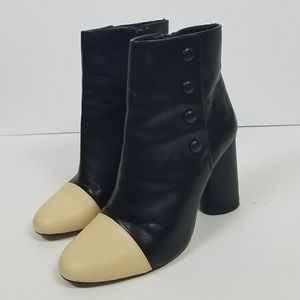 Zara black boots with cream colored toes