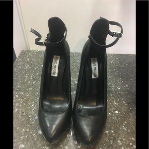 Black leather pumps