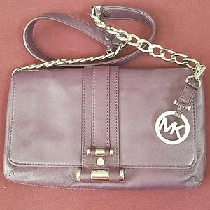Michael Kors purple leather clutch with silver acc