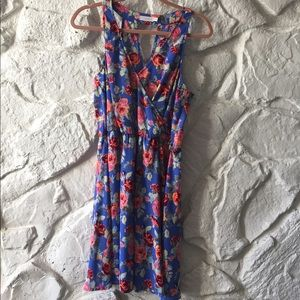Neon short open back dress with flowers.