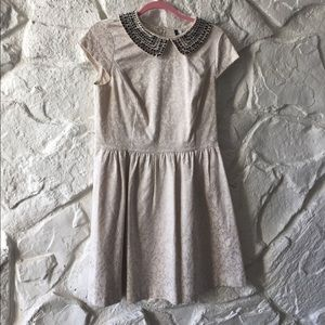 Cream color A-line with beaded Peter Pan collar.