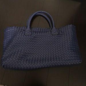 Blue woven handbag