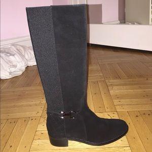 tall black Italian boots