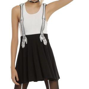 Skeleton hand suspender skirt