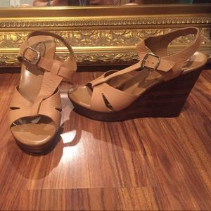 Like new tan with wooden heel wedges