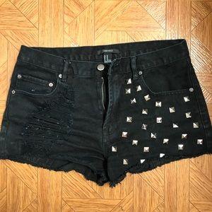 Studded black denim shorts