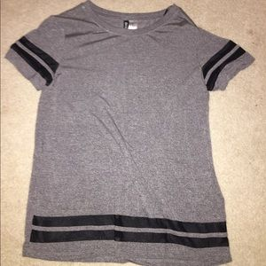 gray tshirt with black jersey material stripes