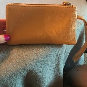 Tan leather like wristlet- NWT, fully lined.