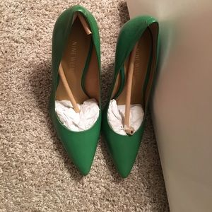 Green leather high heels