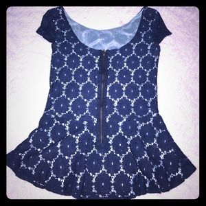 Adorable peplum top with back zipper detail!