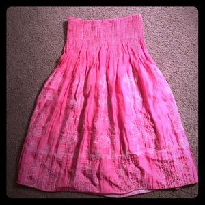 Pink OS dress or bathing suit cover.