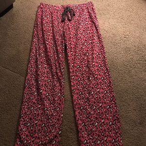 Women's cheetah print pajama pants.