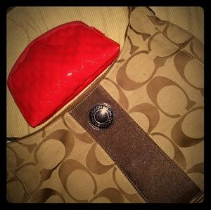 Vibrant red makeup bag to add to any purse