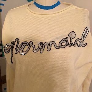 Cream colored Wildfox long sleeve sweater.