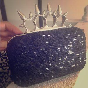 Brass knuckles purse