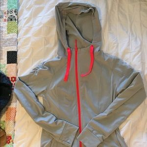 North face zip up. Gray and coral. Very comfy.