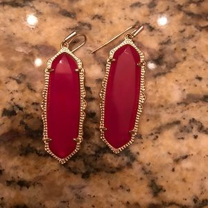 Kendra Scott pink earrings matches the necklace