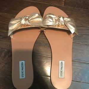Slip on sandals with bows! Worn once