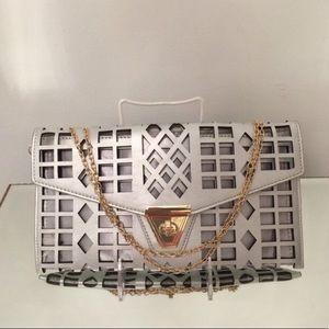 Silver laser cut handbag