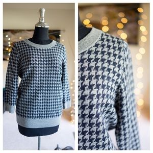 Navy and gray houndstooth crew neck sweater