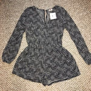 Black and white pattern romper from Macy's.