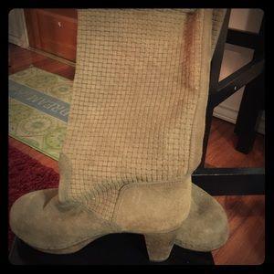 Vintage pair of brown suede boots .