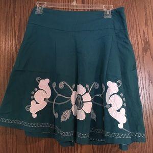 Real thigh-length skirt