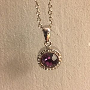 Jewelry - Purple gem necklace surrounded by rhinestones